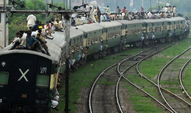 Pakistani Muslims travel on an overloaded train as they head to their hometowns ahead of the Muslim festival of Eid al-Fitr in Lahore on August 18, 2012. Millions of Muslims around the world prepare to celebrate the Eid al-Fitr festival, marking the end of the fasting month of Ramadan. AFP PHOTO/ARIF ALI (Photo credit should read Arif Ali/AFP/GettyImages)